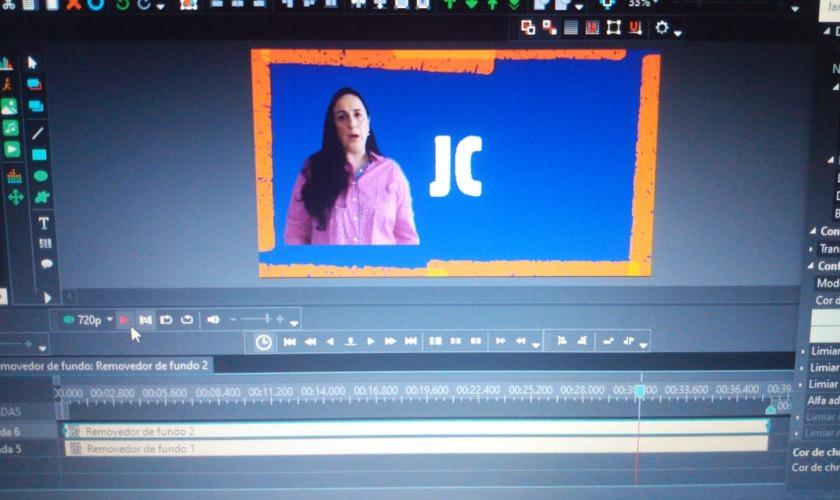 Imagem do programa de edição do vídeo. Há janelas de ferramentas à esquerda, bem como colunas de áudio, abaixo, e a prévia do vídeo ao centro. Fim da descrição.